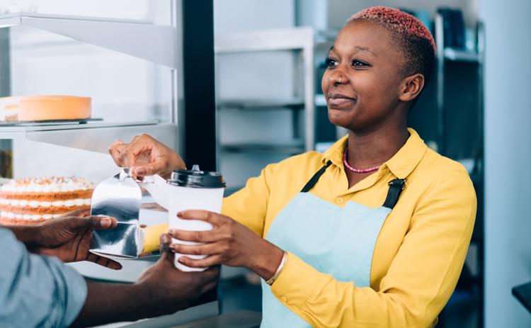 A barista serving a customer